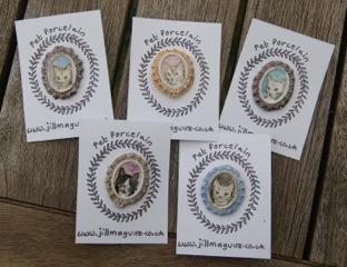 A collection of cat brooches