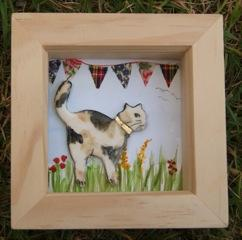 Framed cat in the garde with bunting